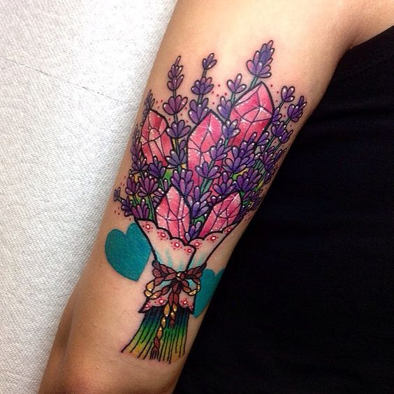 Pink quartz and violet flower bouquet tattoo on the arm