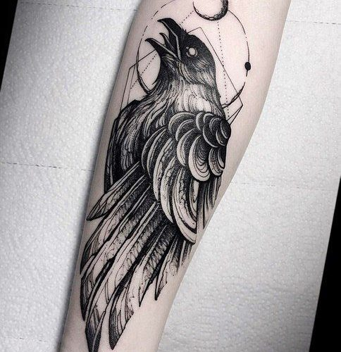 Raven and geometric shapes tattoo on the arm