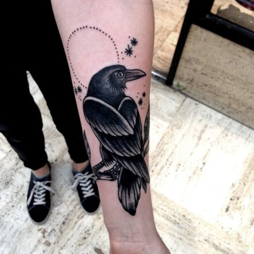 Raven old school style tattoo on the left inner arm