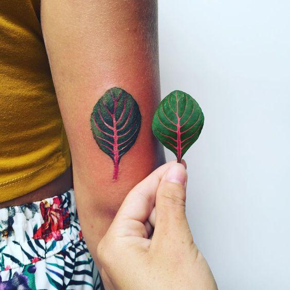 Realistic beet leaf tattoo by tattooist pis saro