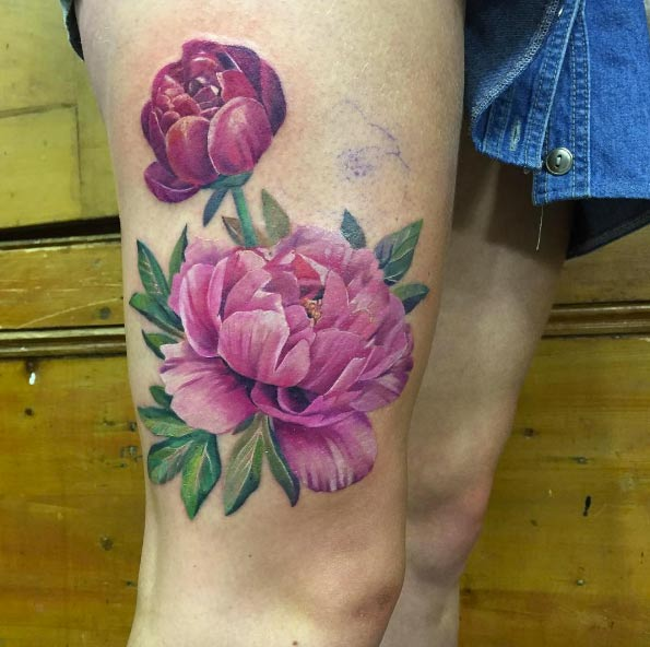 Realistic pink peony tattoo on the right thigh