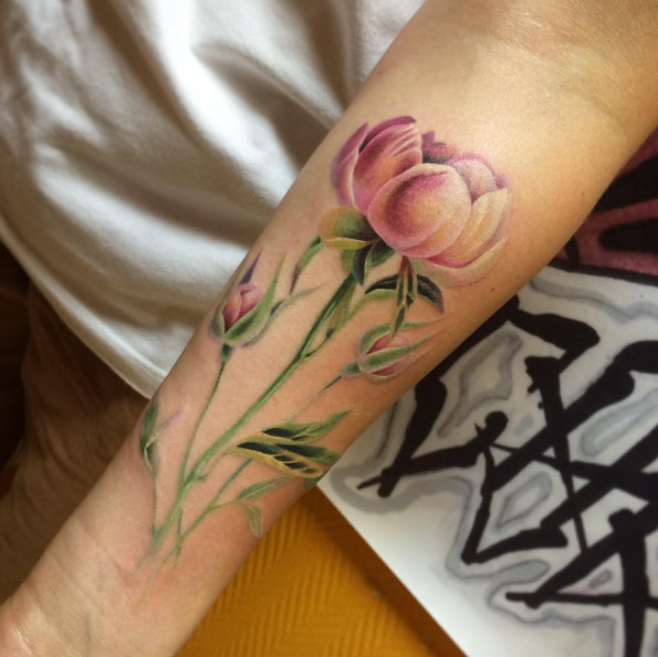 Realistic pink peony with green leaves tattoo by svetlana liubchenko