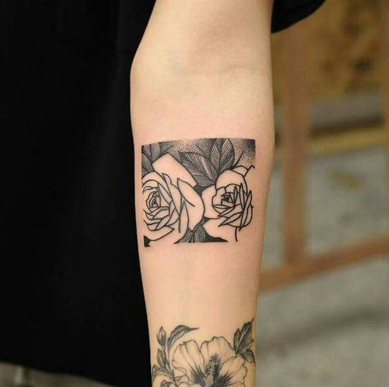 Rectangle roses negative space tattoo on the arm