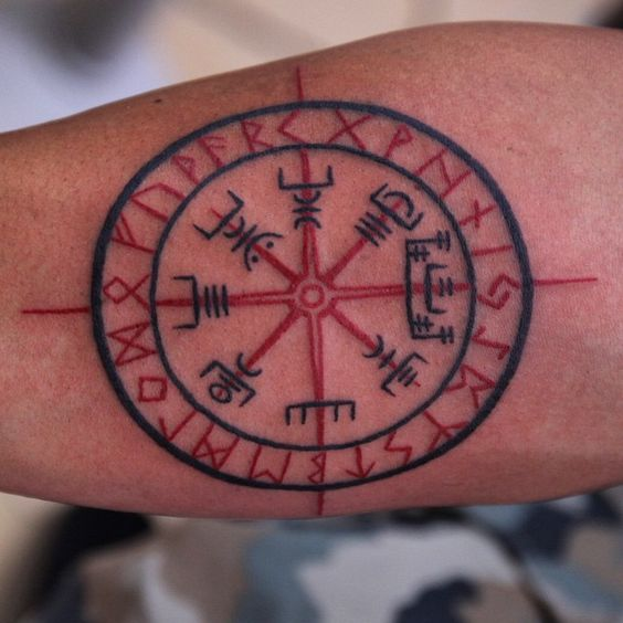 Red and black viking compass tattoo