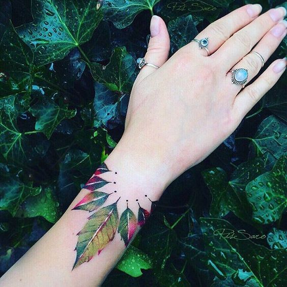 Red and green leaves tattoo on the wrist