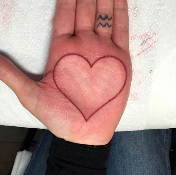 Red heart palm tattoo