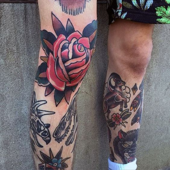 Red traditional rose tattoo on the right knee