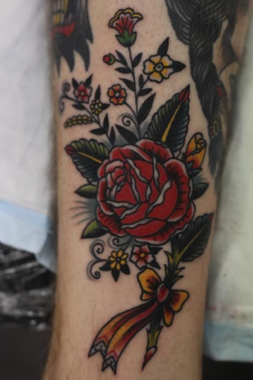 Rose and other wildflowers tattoo on the shin