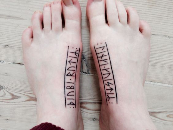 Rune tattoos on feet