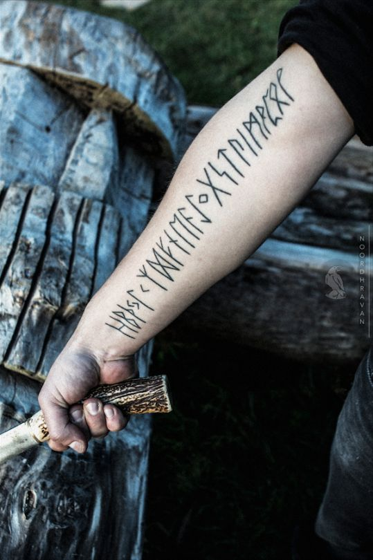 Runic tattoo on the right arm