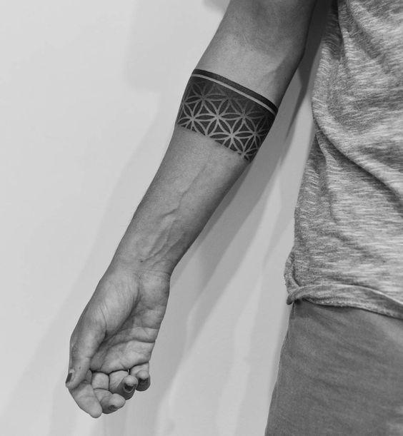 Sacred geometry negative space armband tattoo