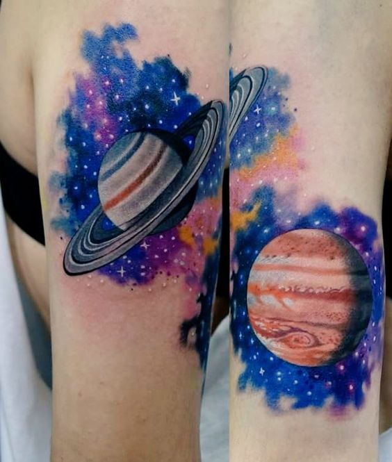 Saturn and jupiter tattoos on arms