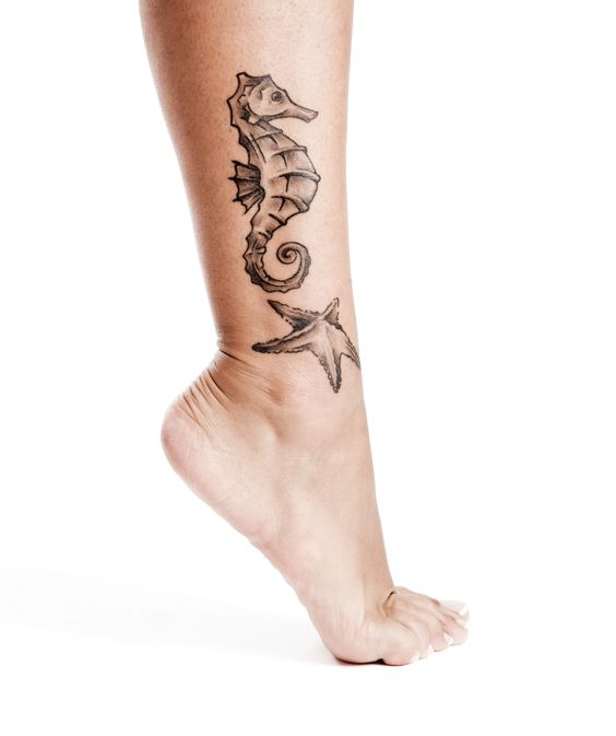 Seahorse and starfish tattoo on the right calf