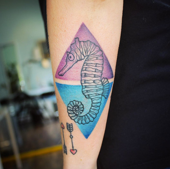 Seahorse in the two colorful triangles tattoo