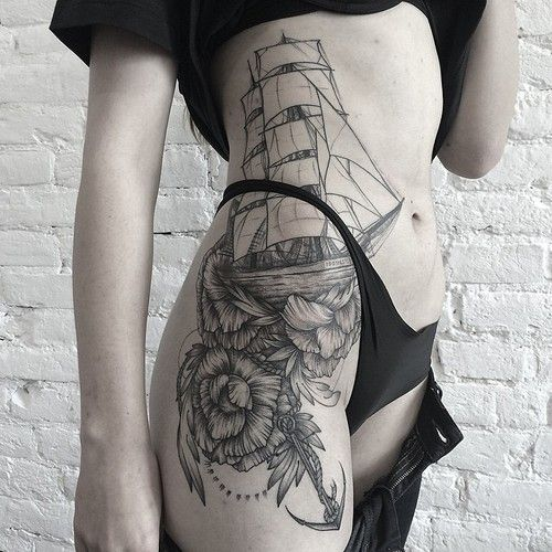 Ship and flower tattoo on the right hip and thigh