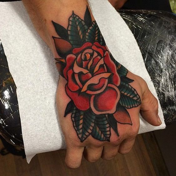 Simple traditional red rose tattoo on the hand