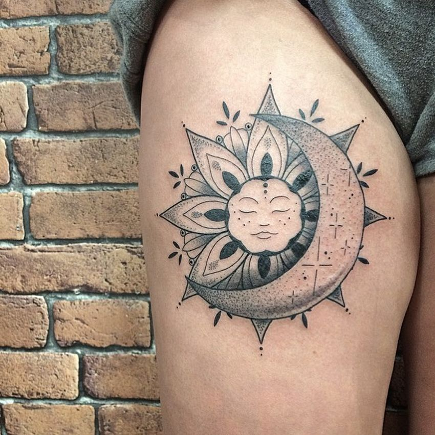 Sleeping sun and moon tattoo on the right thigh