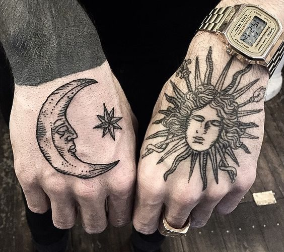 Sleeping sun and moon tattoos on both hands by sue jeiven