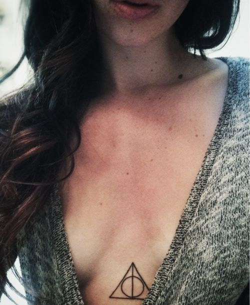 Small deathly hallows sternum tattoo
