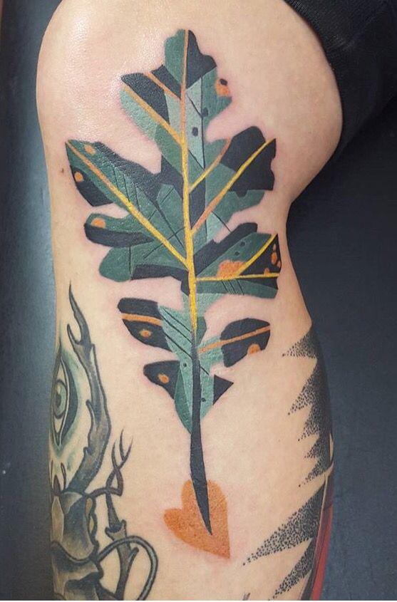 Stylized oak leaf tattoo
