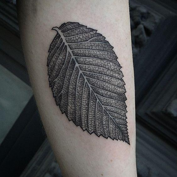 Super detailed black leaf tattoo by susanne suflanda könig