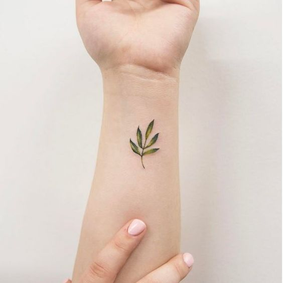 Sweet branch with leaves tattoo on the left wrist