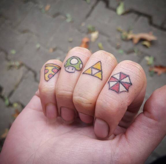 Tiny triforce finger tattoo
