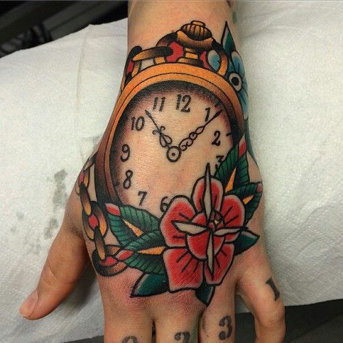 Traditional clock and rose tattoo