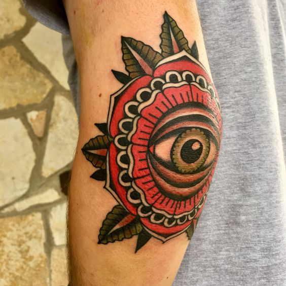Traditional eye tattoo on the elbow