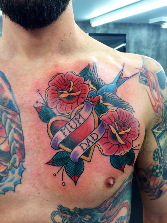 Traditional heart swallows and roses tattoo on the left side of the chest