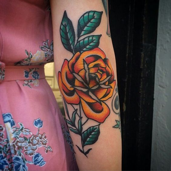 Traditional orange rose tattoo on the left arm