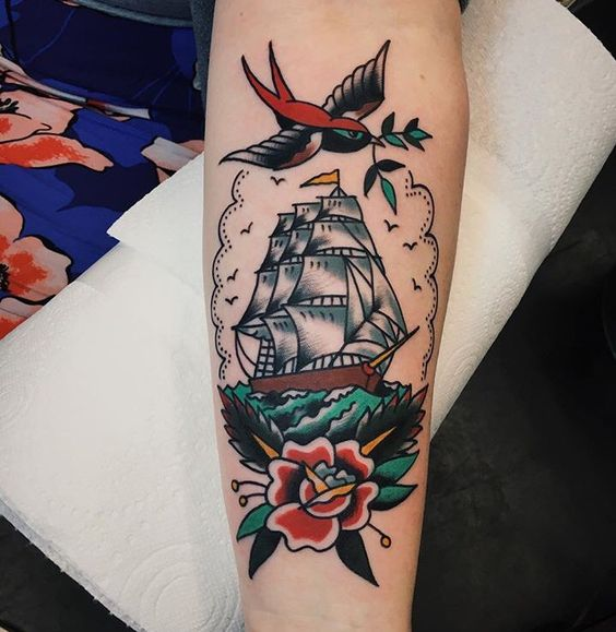 Traditional ship tattoo on the arm