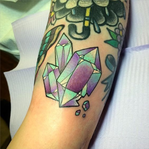 Traditional style diamond tattoo on the arm