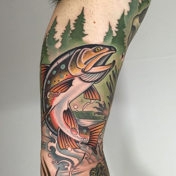 Traditional style fish tattoo on the arm