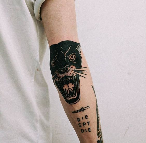 Traditional tattoo of a Panther on the right elbow