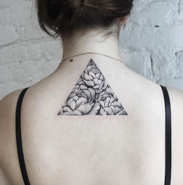 Triangular peony tattoo on the back by dasha sumkina