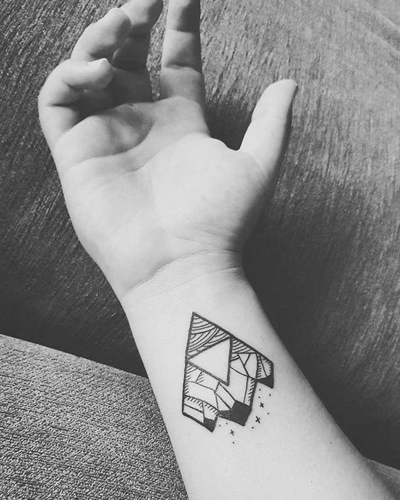 Triforce wrist tattoo