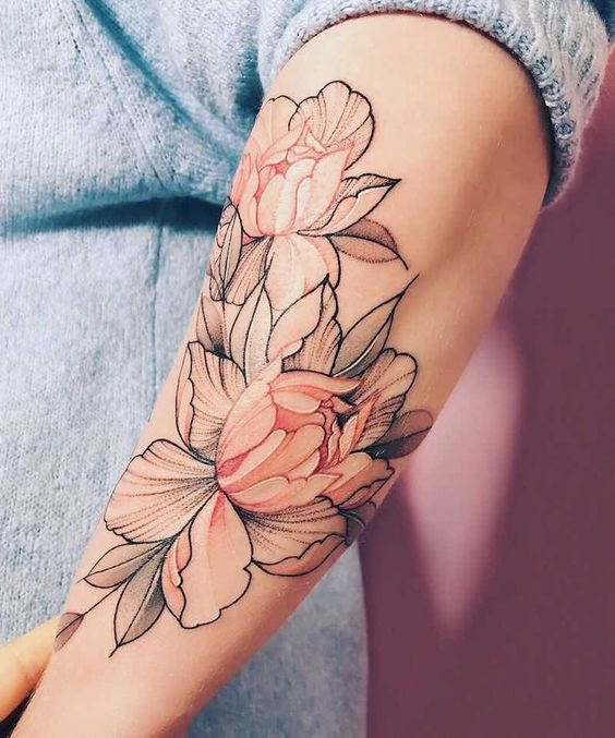 Two peonies tattoo on the left forearm