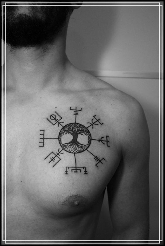 Vegvisir and tree of life tattoo on the left side of the chest