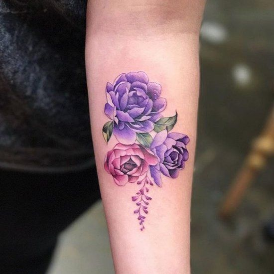 Violet peonies tattoo on the left arm