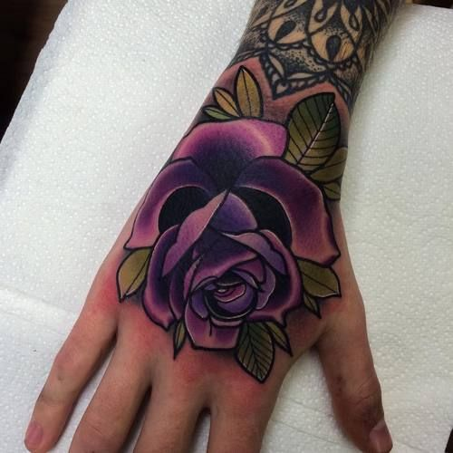 Violet traditional rose tattoo on the right hand