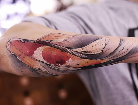 Watercolor Koi Fish tattoo on the right forearm