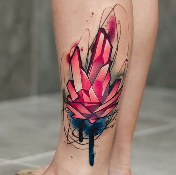 Watercolor pink crystal tattoo on the left calf