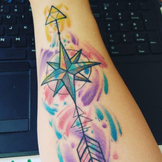 Watercolor triforce with nautical star and arrow on the arm