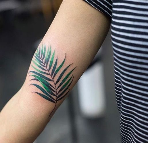 Zihee leaf tattoo on the arm