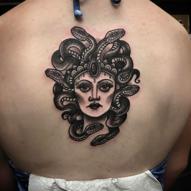 Another traditional black medusa head tattoo on the back