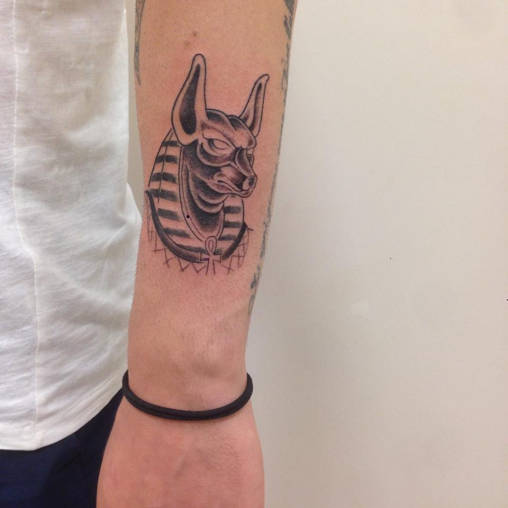 Anubis head tattoo on the forearm