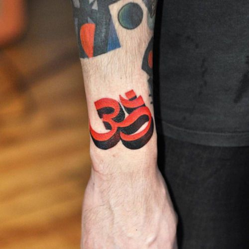 Black and red om tattoo on the right wrist