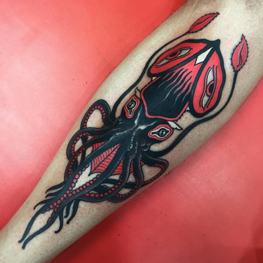 Black and red squid tattoo