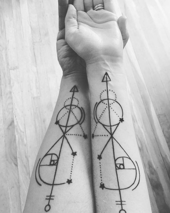 Black linear golden ratio tattoo for a couple
